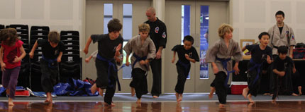 Children running during Kung Fu class
