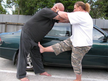 Instructor teaching woman's self defence class